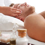 Man has relaxing massage in spa Stock Images