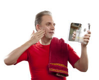 Man has a shave with the razor Royalty Free Stock Photo