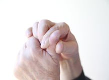 Man has a sore thumb. Older man with pain in his thumb Stock Photography