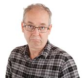 Man has a Stony-Faced. A stony-daced man is looking at the camera Stock Image