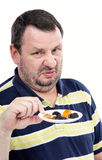 Man has a strong aversion to dried fruits Stock Photography