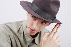 Man with hat. Young man with hat and two fingers pointed at Stock Image