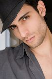 Man with hat. Young handsome man wearing a black hat Stock Photo