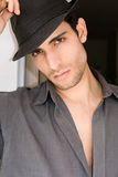 Man with hat. Young handsome man wearing a black hat Stock Photography