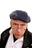 Man in hat. Portrait of man glaring at viewer in hat and coat, on white Stock Photography