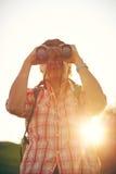Man Hat Binoculars Lens backlight Stock Images