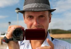 Man in a hat with a camera Royalty Free Stock Photo