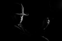 Man in hat with cigar Royalty Free Stock Photography