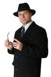 A man in a hat and coat Stock Image