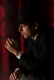 Man with hat in darkness Royalty Free Stock Image
