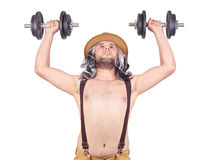 Man in hat with dumbbells royalty free stock photography