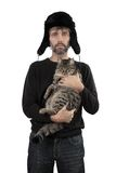Man in hat ear flaps holding cat. Adult man in hat ear flaps holding cat isolated white Royalty Free Stock Photos