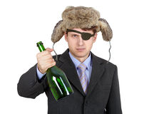 Man in hat earflaps, offers to drink alcohol Royalty Free Stock Photography