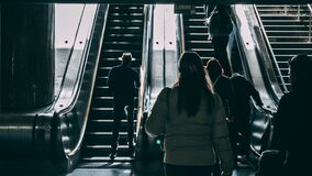 Man in Hat at Escalator Royalty Free Stock Images