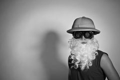 Man in a hat with a false beard Royalty Free Stock Photo