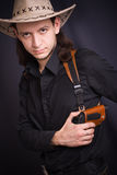 Man in hat with gun. On black Royalty Free Stock Photography