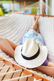 Man in hat in a hammock on a summer day Stock Images
