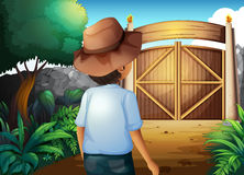 A man with a hat inside the gated yard Royalty Free Stock Image