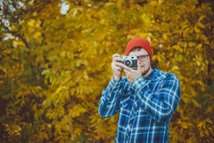 Man in a hat making picture Stock Images