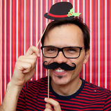 Man with hat and mustache. Man with props: black hat and mustache at new year Stock Photography