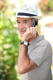 Man with hat and phone Royalty Free Stock Images