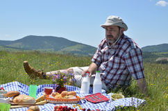 Man with Hat on Picnic Stock Image