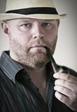 Man with Hat and Pipe Stock Image