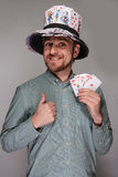 Man in the hat of playing cards Stock Photos