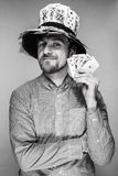 Man in the hat of playing cards Royalty Free Stock Photos