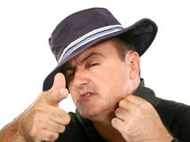 Man In Hat Pointing. Confident man in hat looking at camera and pointing Royalty Free Stock Photography