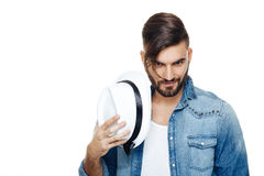 Man with a hat posing in the studio Stock Photography
