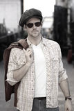 Man in hat and shades outdoors Stock Photos