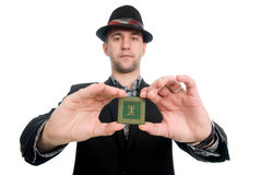 The man in the hat showing a microchip computer Stock Photography