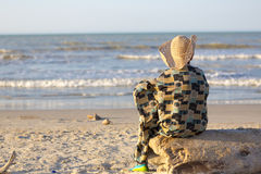 Man with hat sitting and looking at the ocean in Colombia Royalty Free Stock Photo