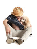 Man in a hat sitting with a poodle Stock Photos