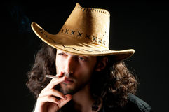 Man in  hat smoking Royalty Free Stock Images
