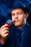 Man with Hat Smoking a Pipe Close Up Stock Photo