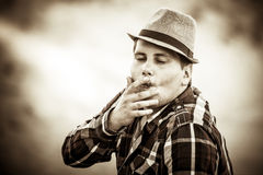 Man with hat smoking Stock Photography