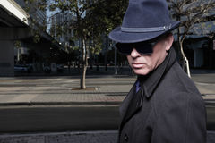 Man with a hat and sunglasses Royalty Free Stock Photography