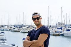 Young Handsome Man on a port in Spain royalty free stock photography
