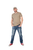 Man with hat, t-shirt and jeans standing, isolated on white Royalty Free Stock Photo