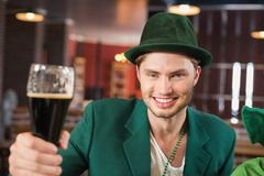 Man with a hat toasting a beer Stock Photos