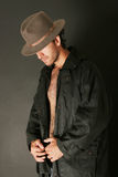 Man with hat and trenchcoat. Attractive man with hat and trenchcoat Royalty Free Stock Photo