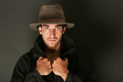 Man with hat and trenchcoat Stock Images