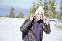 Man with hat in the winter mountain Stock Photos