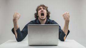 Man hating computers and technology Stock Image