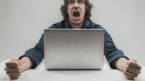 Man hating computers and technology Royalty Free Stock Images