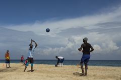 Man from a Havana soccer team throwing a ball towards a colleague royalty free stock image