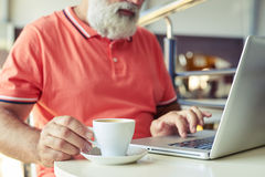 Man have a coffee break with laptop Stock Images