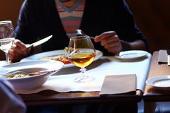 Man have a dinner at the restaurant Royalty Free Stock Images